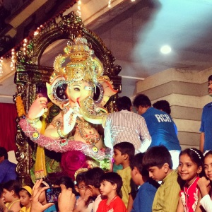 A Ganpati being paraded around a compound before immersion at Juhu Beach.